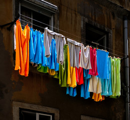 Low Angle View Of Multi Colored Clothes Hanging On Clothesline