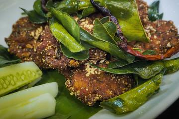 Fried pork with kaffir leaf.