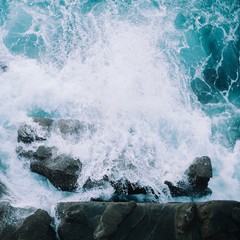 Wave Splashing On Rocks