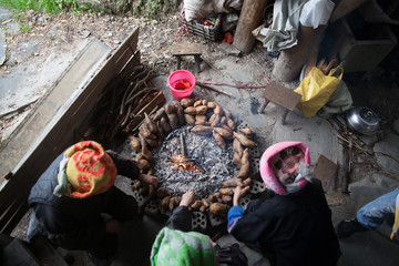 Women Preparing Food At Kitchen Fire