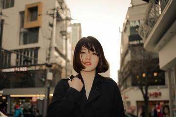 Portrait Of Woman Standing In Street