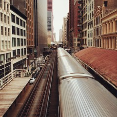 View of railroad tracks passing through city