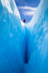 Low Angle View Of Person Standing On Glacier