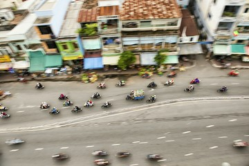 High Angle View Of People Riding Motorcycle On Road