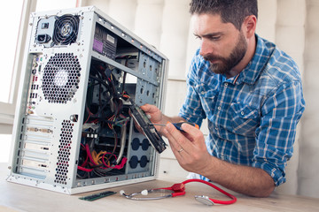 Engineer repairs computer's hard drive