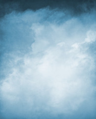 Wall Mural - Blue Textured Cloudscape. An abstraction of clouds and fog on a textured grunge background and toned blue.  Image displays a distinct paper grain and texture at 100 percent.