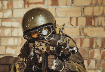 The man in the image of a member of the special forces division. Russian police special force - Special Rapid Response Unit or SOBR (Spetsnaz).
