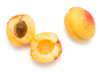 yellow apricots on a white background