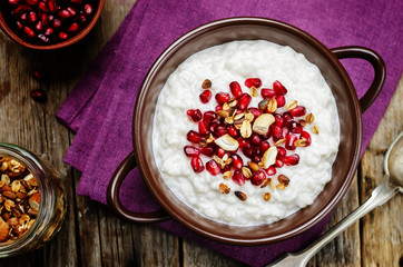 Coconut rice with pomegranate and granola