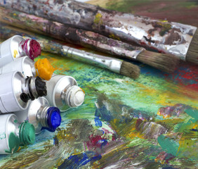 Paint colors and brushes on artist palette
