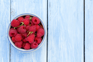 raspberry on wooden surface