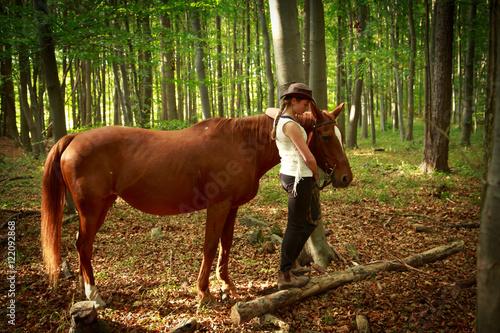 quotcowgirl mit pferd im waldquot stock photo and royaltyfree