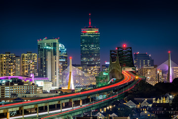 Wall Mural - Rush hour traffic on Tobin bridge (aka Mystic River bride) heading towards Zakim bridge and Boston skyline by night