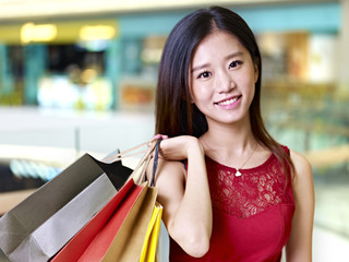 young asian woman on a shopping spree