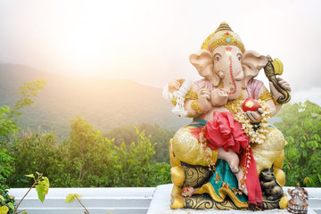 A beautiful statue of Ganesh On the background landscape