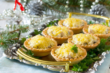 Tartlets with mushrooms, mushrooms, chicken and cheese on a Chri