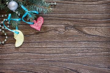 Christmas frame. Christmas tree branches and Christmas toys made