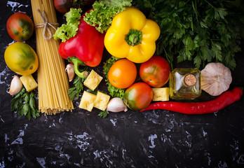 Concept of Italian food. Pasta, tomato, olive oil, pepper, parsl