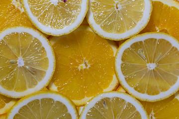 Juicy mix of lemon and orange slices isolated on white background