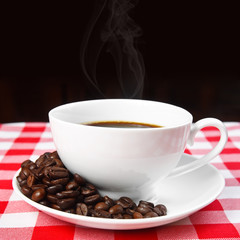 beans & hot coffee in white cup with smoke