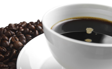 dark coffee in white cup with beans, isolated