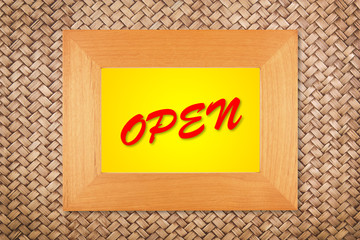 open text in modern picture frame on rattan