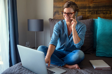 Work from home student studying casual bedroom older woman mother online class