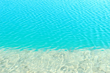 Blue water background and ripple surface.