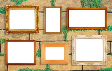 Multiple picture frames on beautiful wall