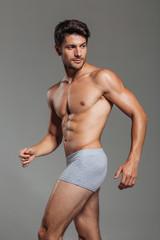 Handsome attractive man in underwear posing