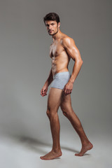 Portrait of a athletic man in underwear looking at camera
