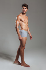 Portrait of a serious muscular man in underwear looking away
