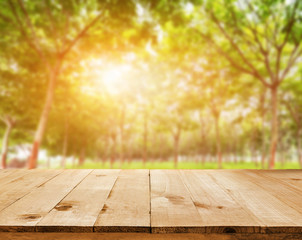 Wood table top on shiny sunlight bokeh background - can used for