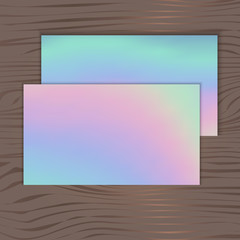 holographic background for business cards on a wooden background