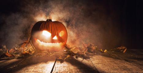 Scary halloween pumpkin on wooden planks