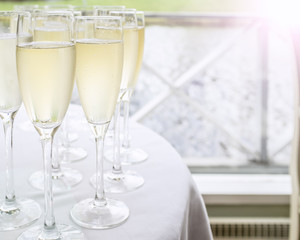 glasses with champagne stand on a table on the deck