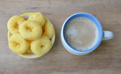 mini donuts on cup and milk coffee