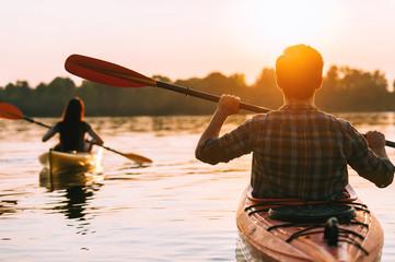 Meeting sunset on kayaks.