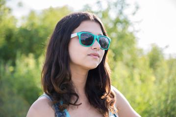 Portrait of beautiful teen girl in sunglasses