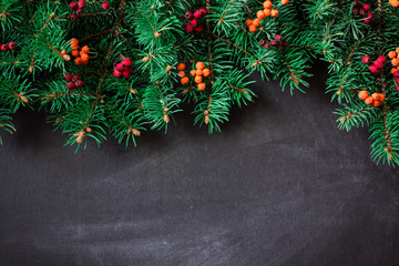 Christmas fir tree with decoration on dark wooden board. soft focus