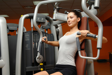 woman training chest in gym