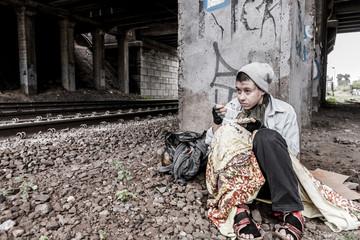 Homeless woman having meal