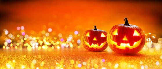 Halloween Pumpkin With Lights And Sparkle Bokeh Background  Fotoväggar