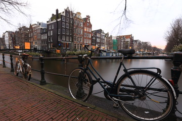 Bicycles on a bridge over the canals of Amsterdam, Netherlands