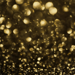 ..Dark Gold Festive blur background. Abstract night twinkled bri