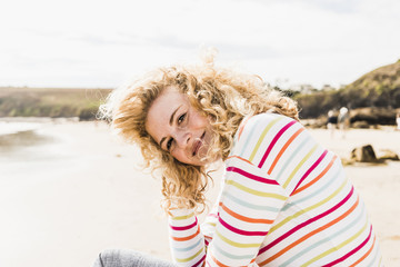 Portrait of smiling teenage girl on the beach