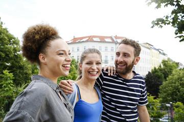 Three happy friends outdoors