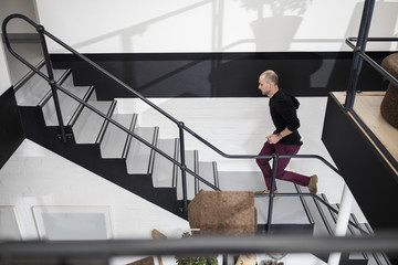 Staff running up stairs