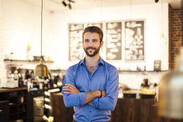 Confident young man in a cafe