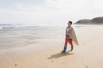 Mature woman walking on the beach